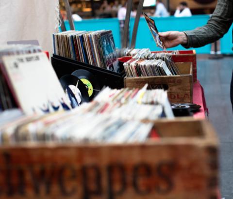 A shopper picks through records at the Tulsa Flea Market, an event occurring at Expo Square in Tulsa, Oklahoma.