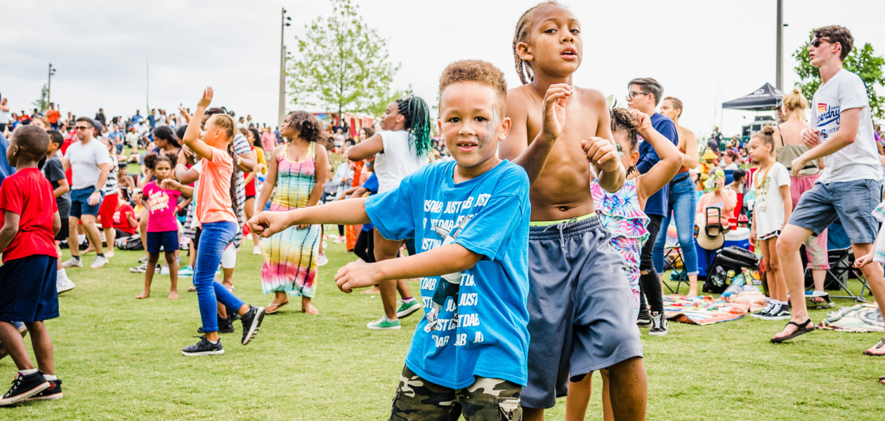 Kids play at Gathering Place in Tulsa, Oklahoma during the event Caribbean Vibes. The world-class park hosted the event to celebrate diversity and culture.