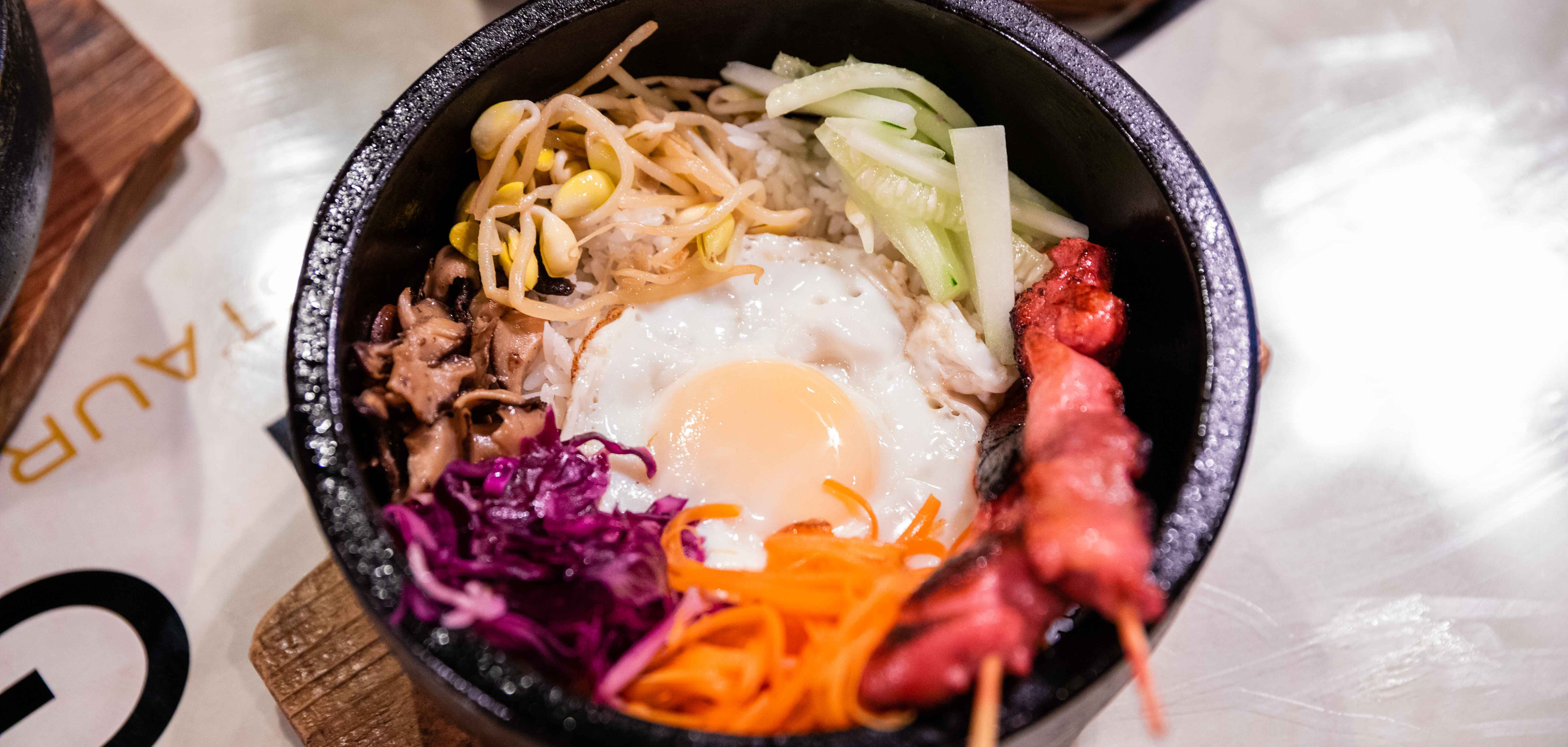 A bibimbap rice bowl at Gogi Gui in East Tulsa topped with a fried egg