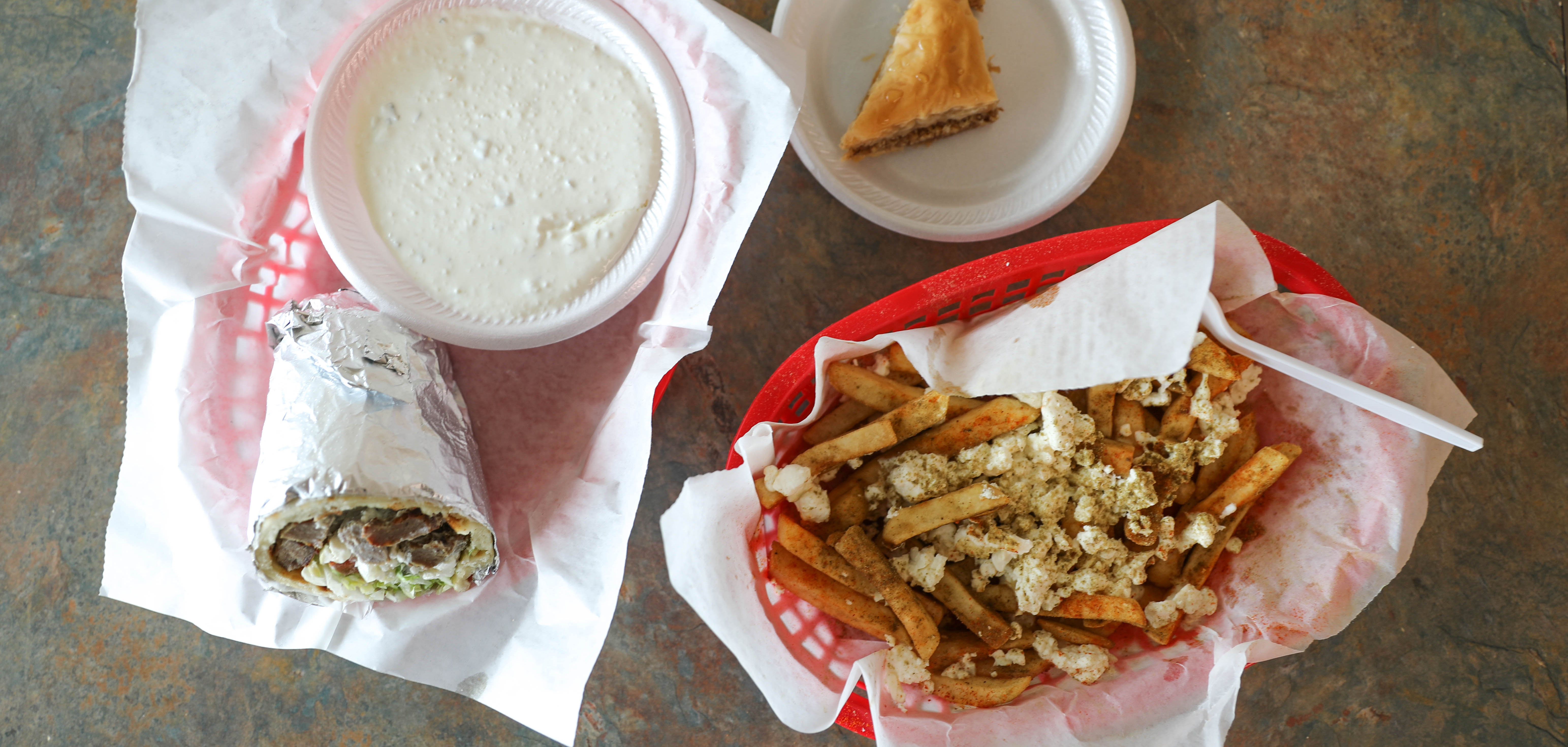A gyro, baklava, and Greek fries topped with feta chese at Gyro Palace in East Tulsa.