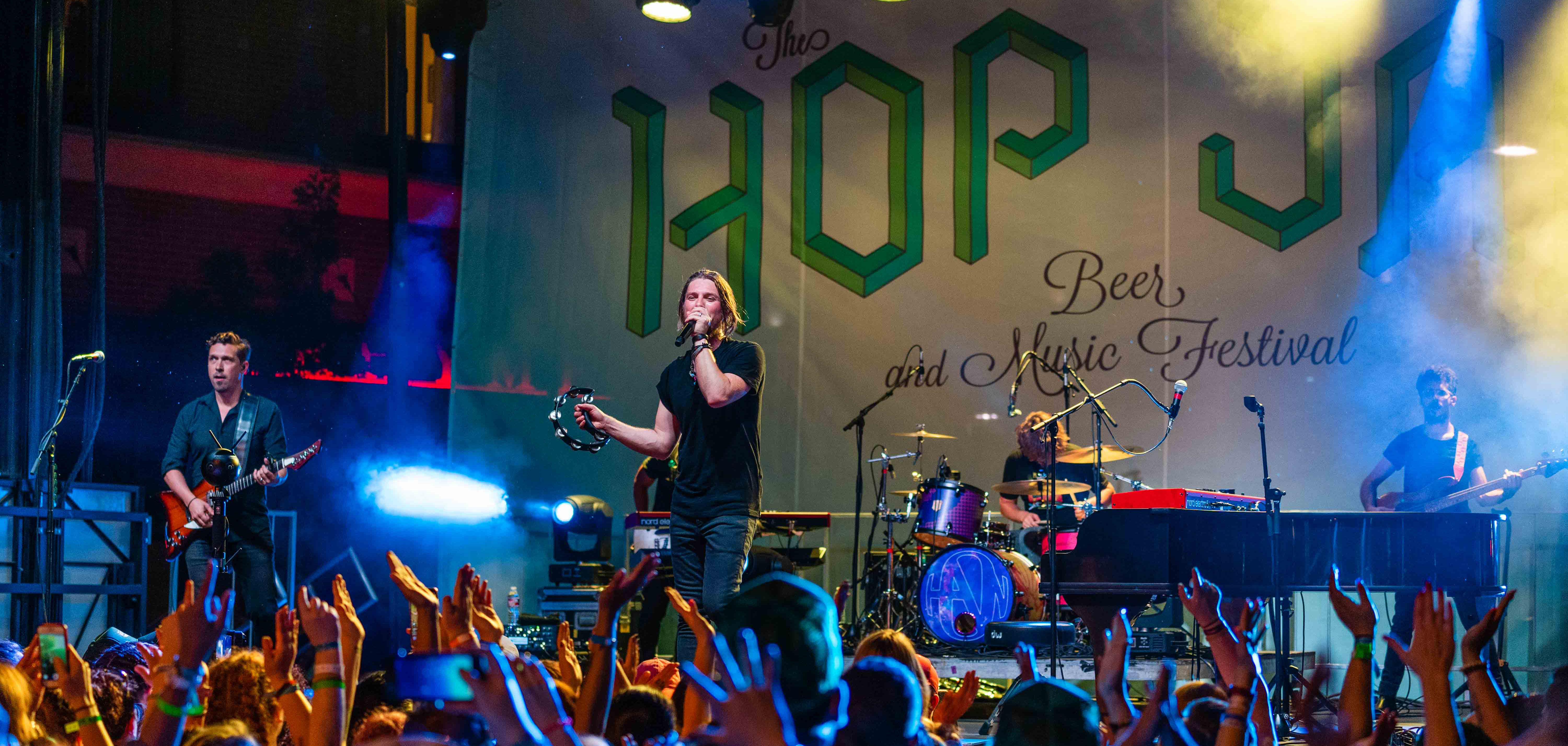 Hanson performing at their own music festival, Hop Jam, in downtown Tulsa's Arts District.
