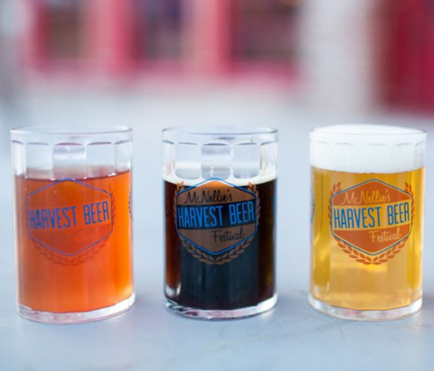 Three beer glasses with the McNellie's Harvest Beer Festival in Tulsa, Oklahoma.