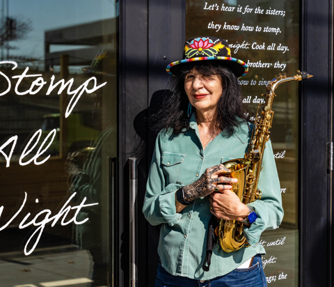 Joy Harjo in front of her Storefront Series installation at Tulsa Artist Fellowship in the Arts District.