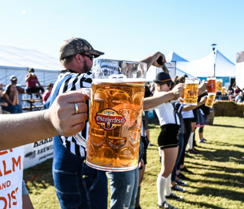 Competitors hold up a stein of beer at Linde Oktoberfest, an annual festival event held in Tulsa, Oklahoma.