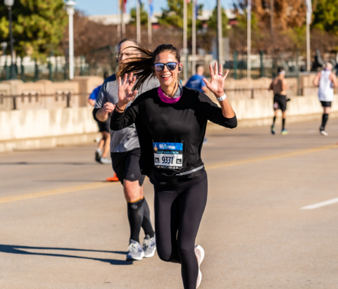 A runner mugs for the camera ahead of the 2021 Golden Driller Marathon event in Tulsa, Oklahoma.