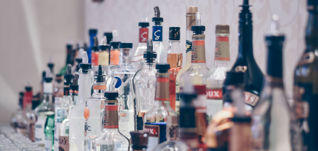 Liquor sits on a bar at an upscale restaurant like Oren on Tulsa's Brookside.