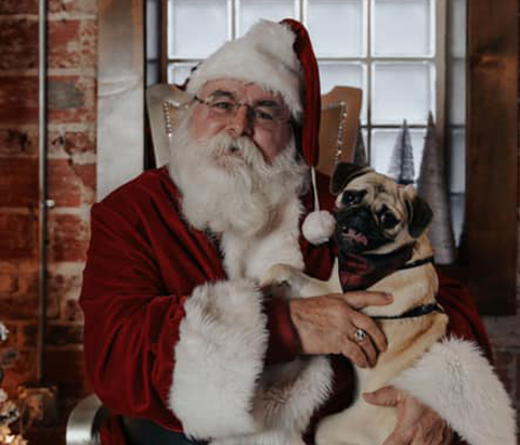 Santa with a puppy at Nothing's Left Brewing Co. in Tulsa's Pearl District.