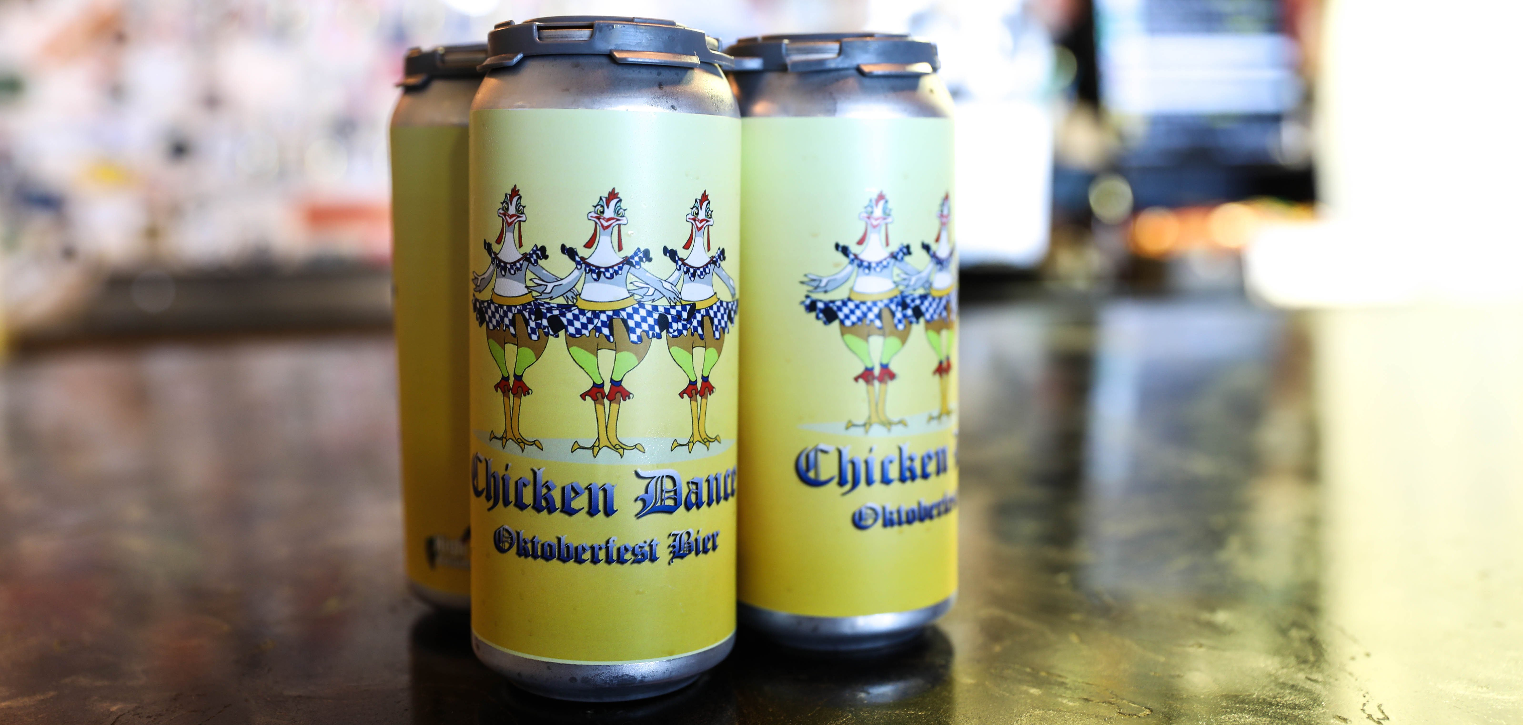 """Cans of the """"Chicken Dance Oktoberfest"""" sit on the bar at Pippin's Taproom"""
