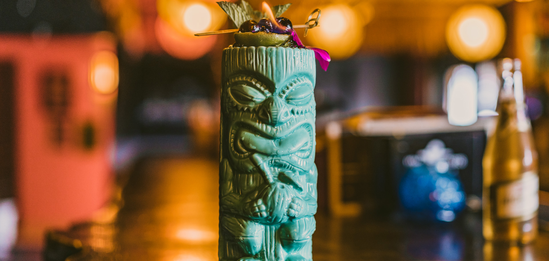 A cocktail in a tiki glass at Tulsa Arts District bar Saturn Room.