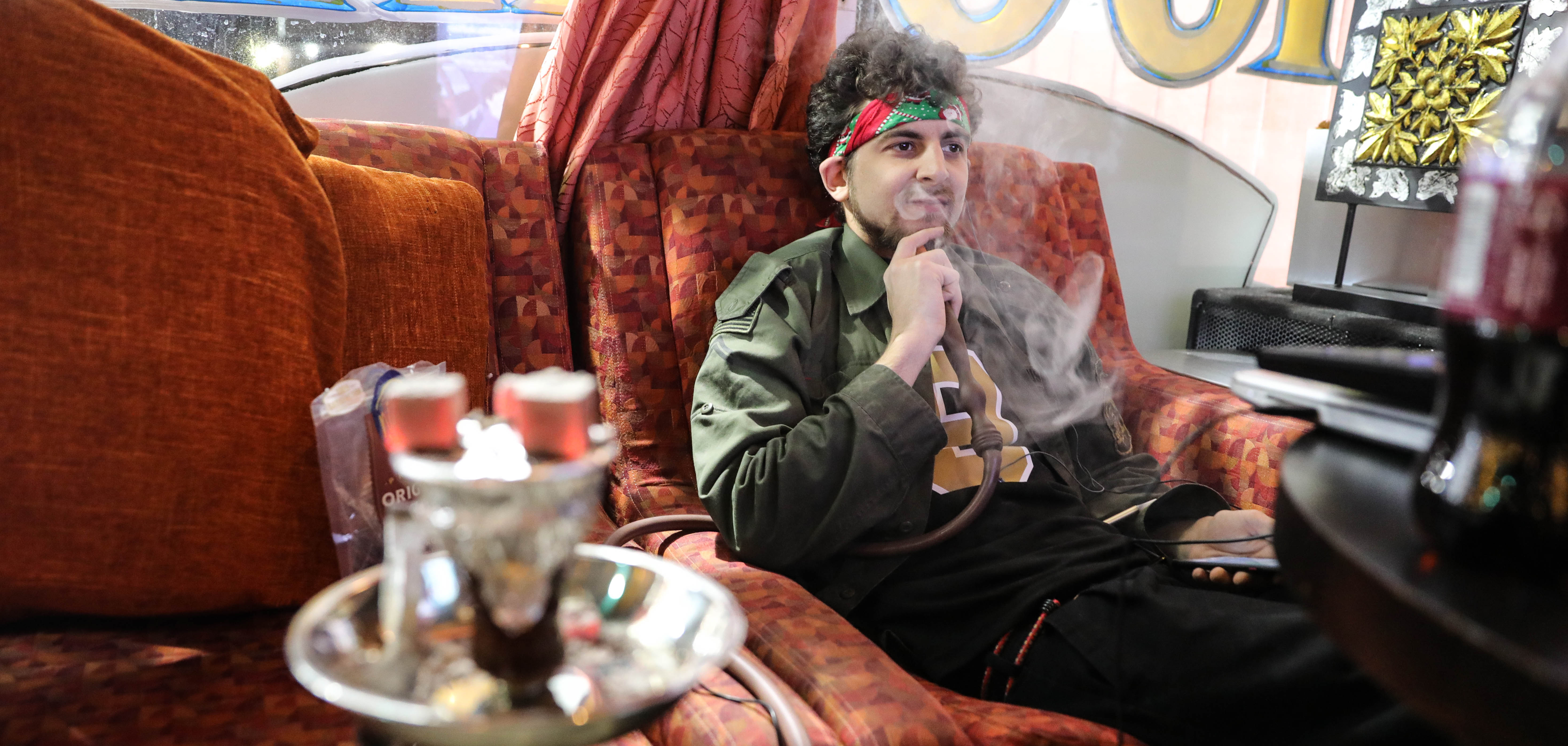 A man smokes at Star Avenue Hookah Lounge on Tulsa, Oklahoma's Route 66.