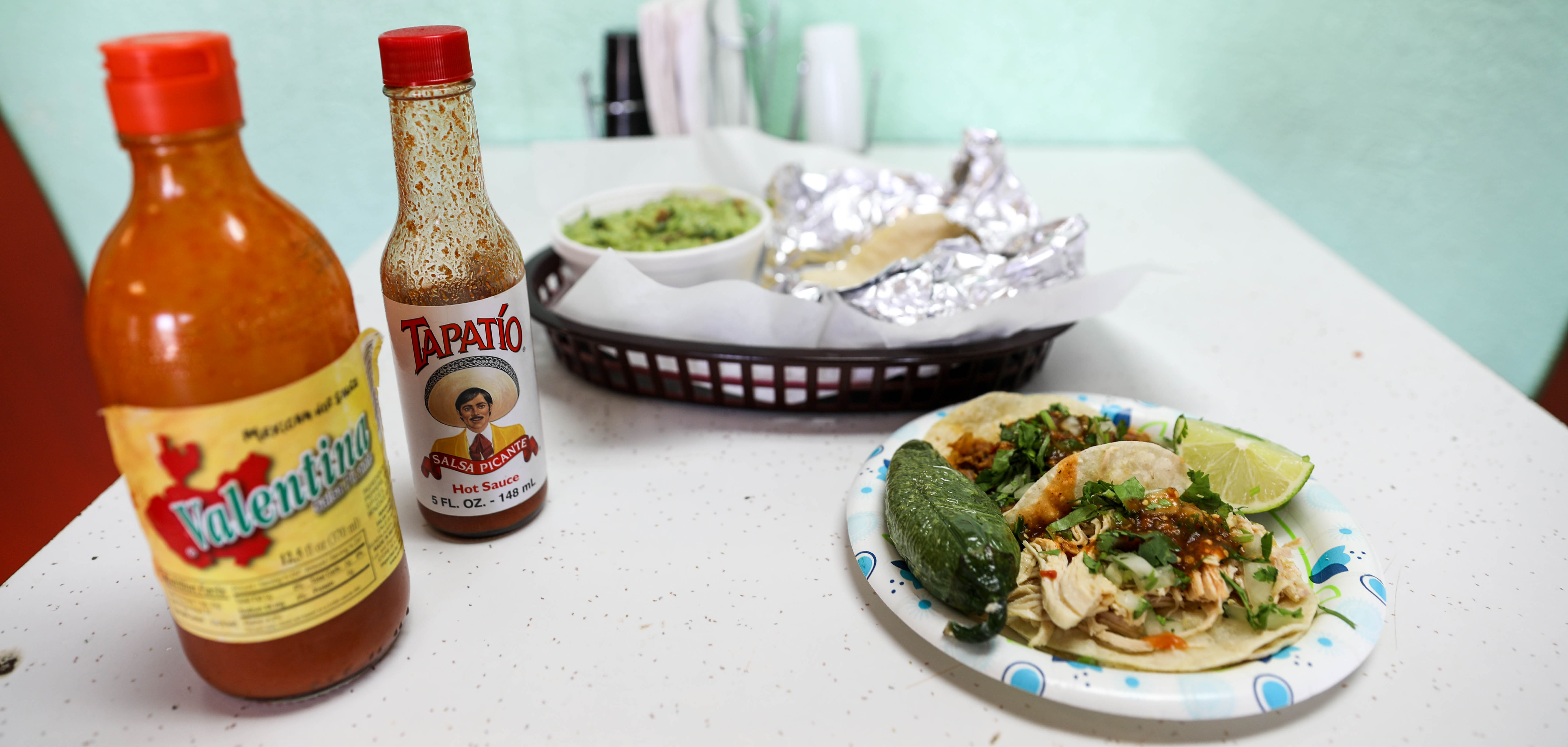 Hot sauce, guacamole, and tacos at Tacos Don Francisco on Tulsa's Route 66.