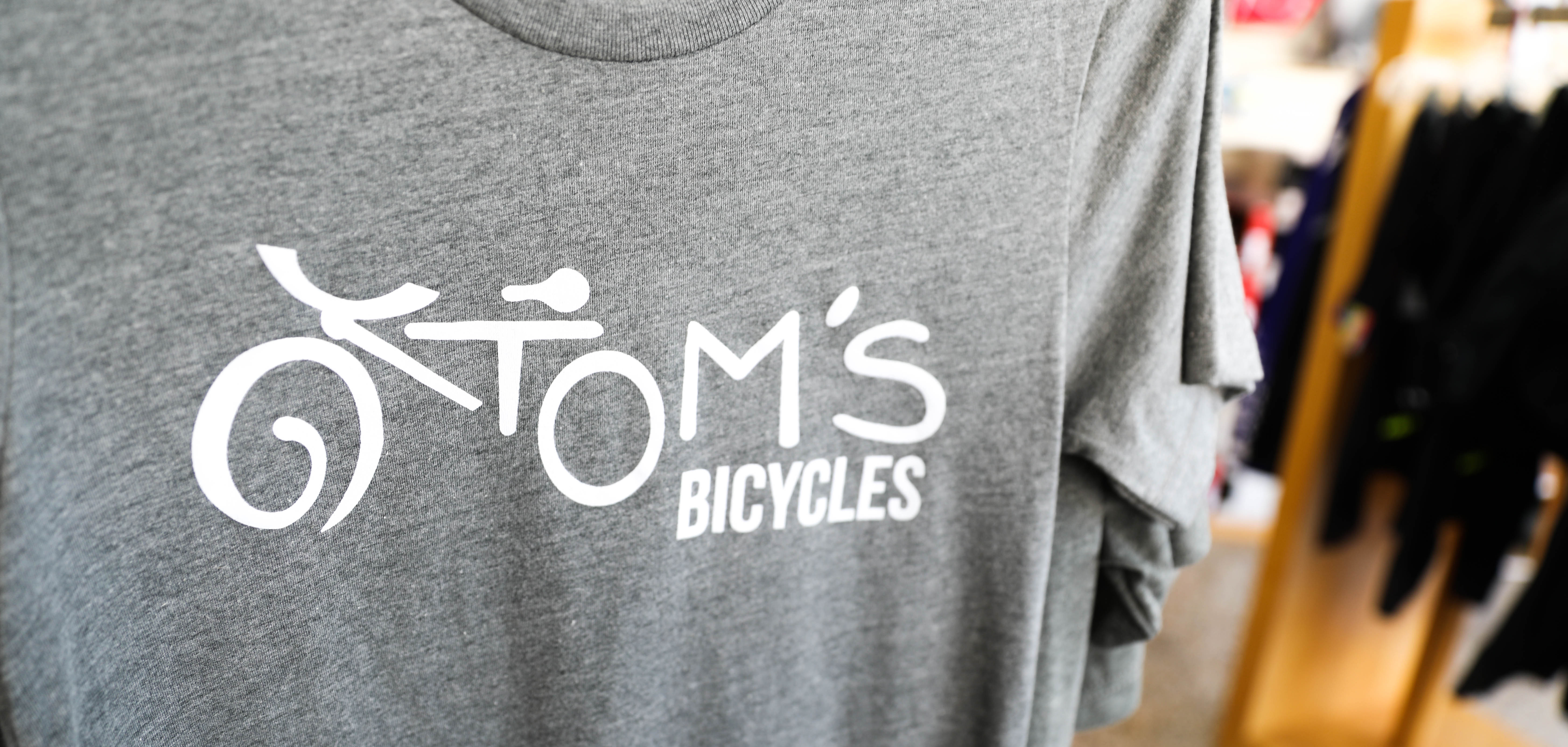 A t-shirt at Tom's Bicycles with the Tom's Bicycles logo on Tulsa's Root 66.