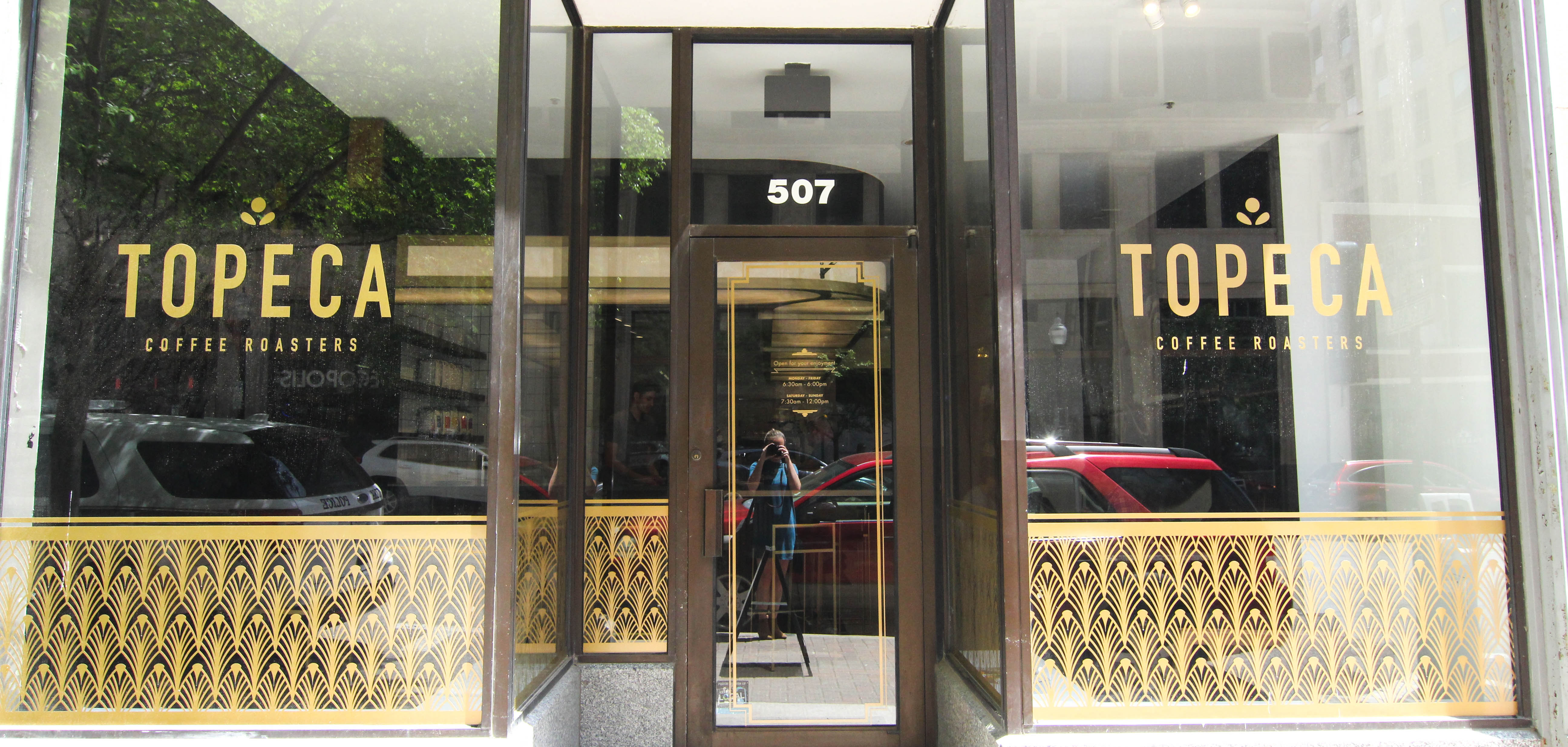 The exterior of Topeca Coffee with gilded Art Deco motifs in downtown Tulsa's Deco District.