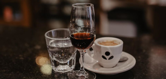Wine and Irish coffee are included in the Topeca Coffee Happy Hour downtown.