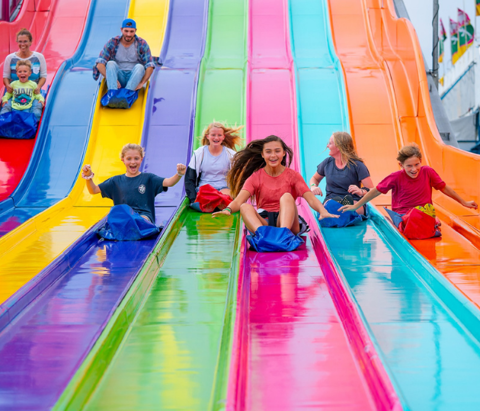 Children ride down a slide at the Tulsa State Fair, an annual event held at Expo Square in Tulsa, Oklahoma.