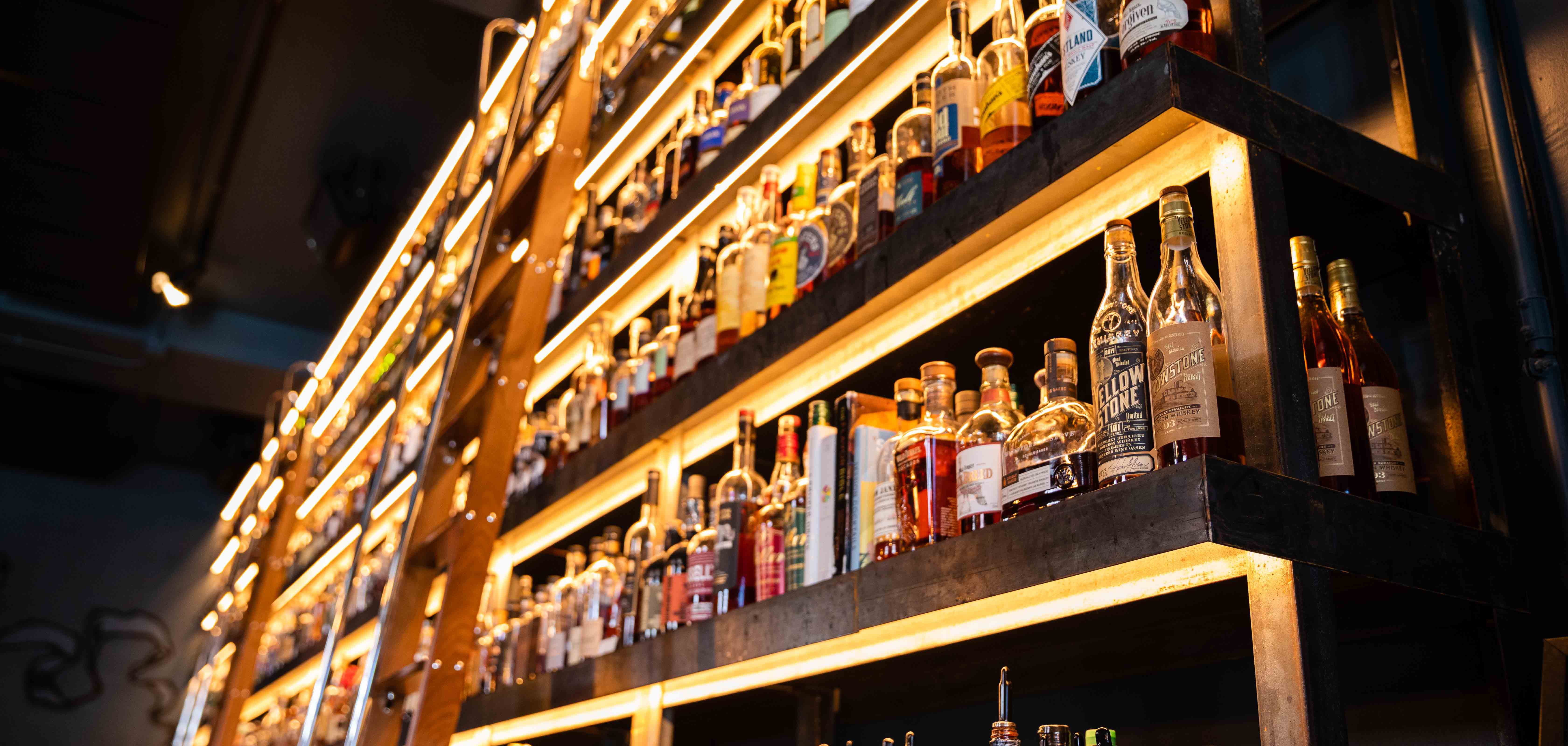 A ladder helps bartenders reach all of libations at upscale Tulsa Arts District bar, Valkyrie