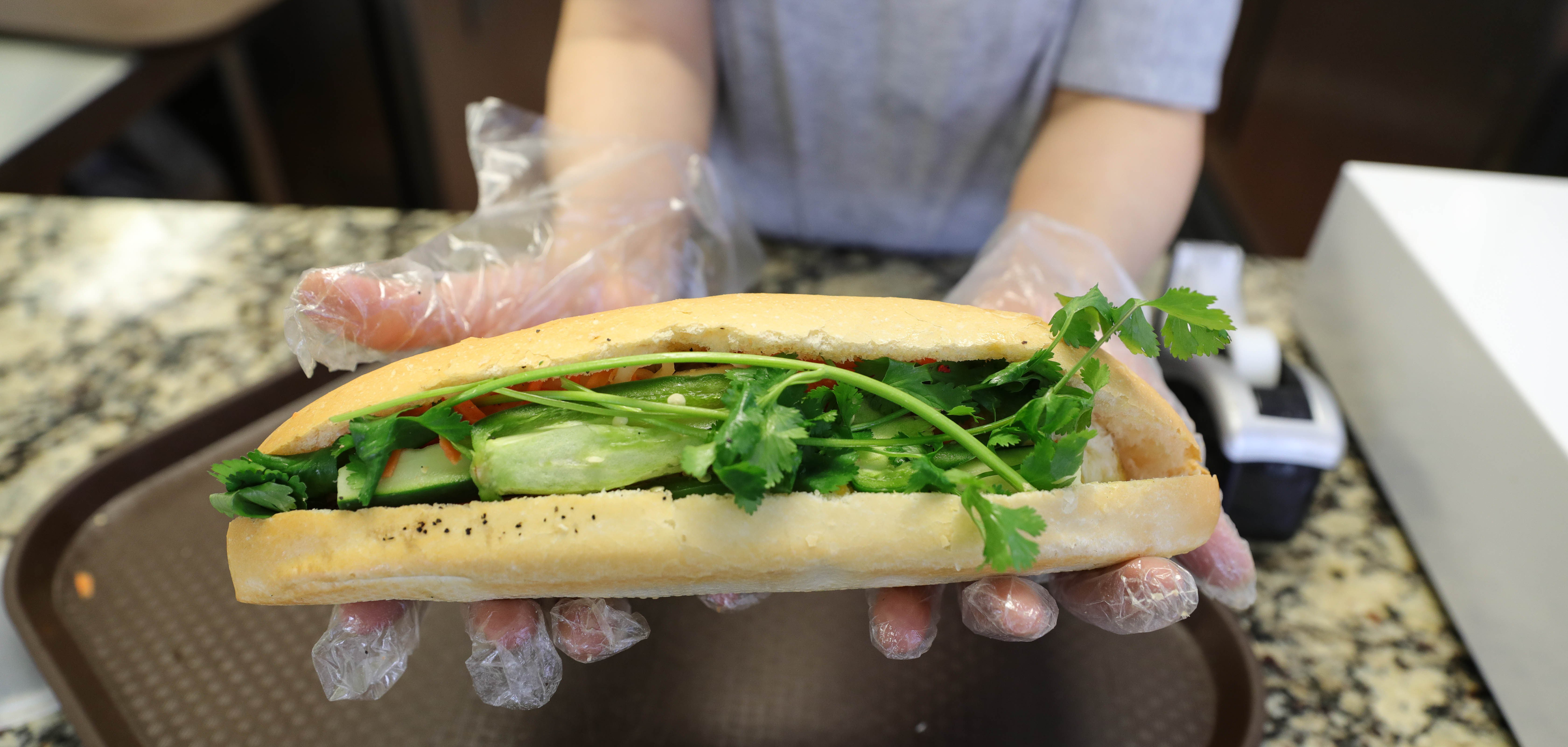 A baguette filled with meat, cucumber, and cilantro at Viet Hot Bread in East Tulsa.
