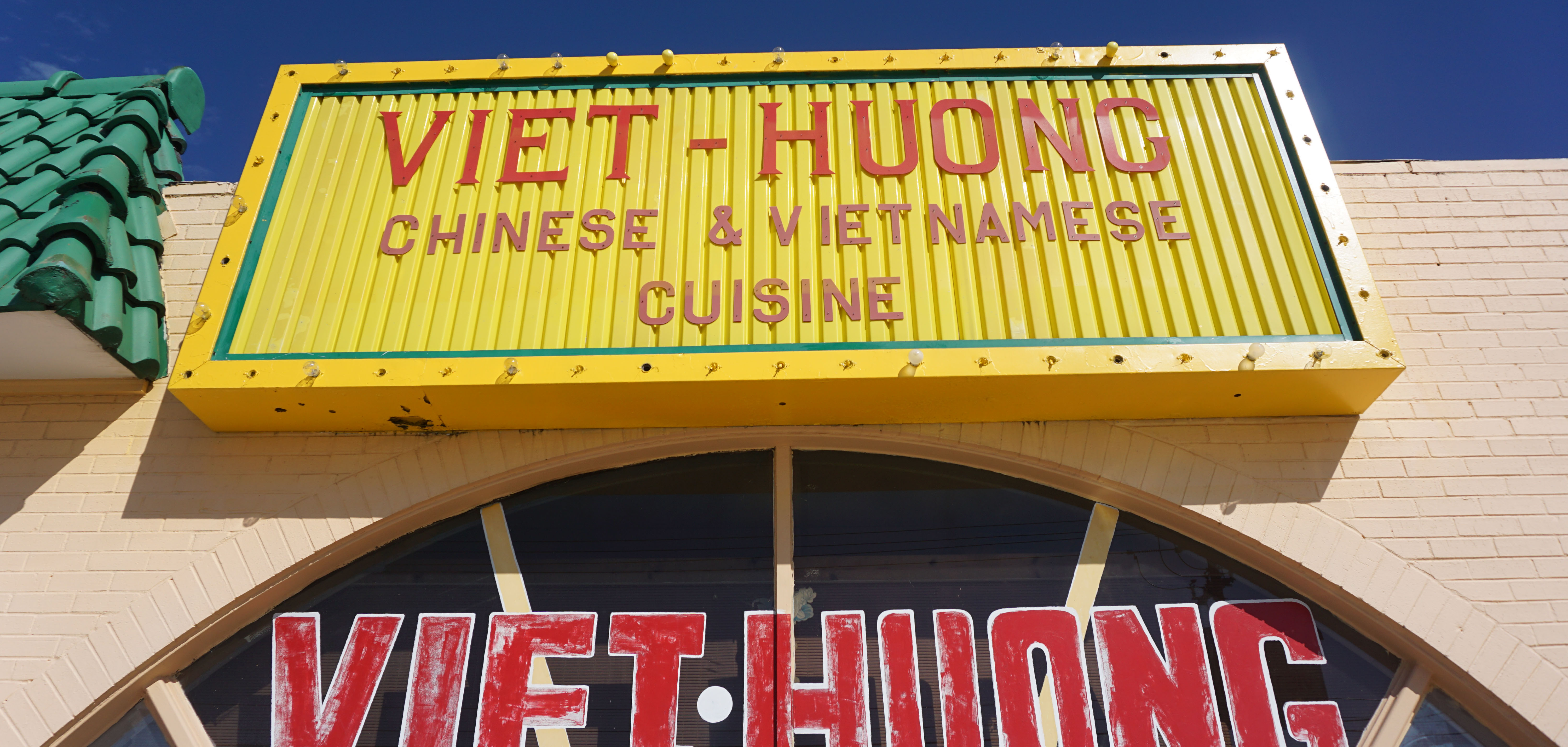 """The bright yellow sign outside of Viet Huong advertising """"Chinese and Vietnamese Cuisine"""" in East Tulsa"""