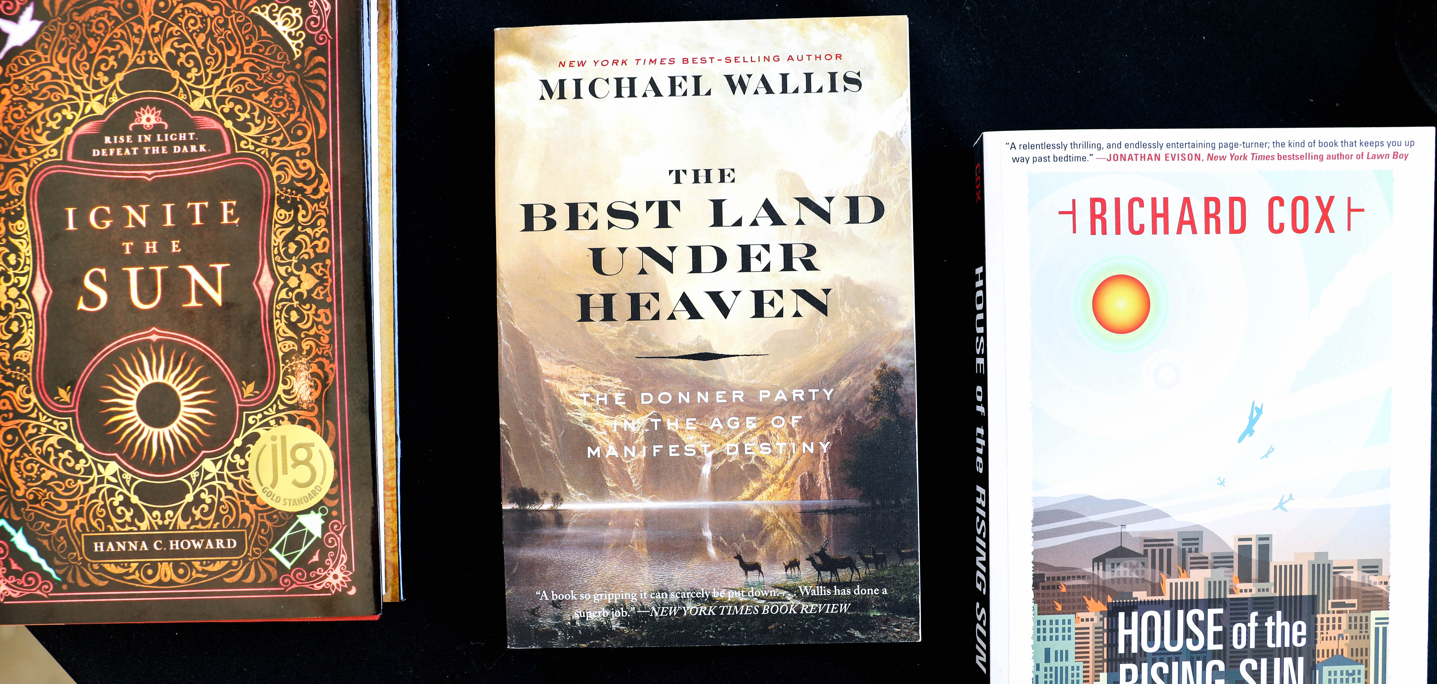 """""""The Best Land Under Heaven: The Donner Party in the Age of Manifest Destiny"""" by Michael Wallis sits on a table at a bookstore in the Tulsa Arts District."""