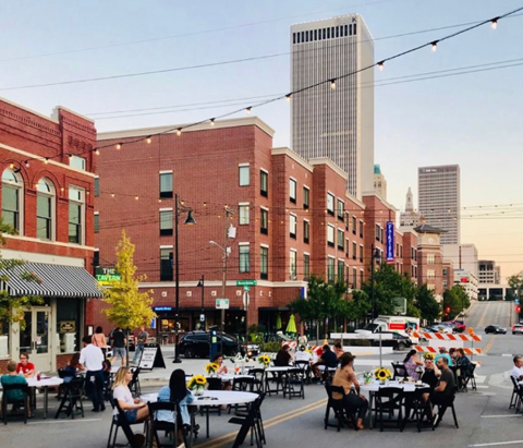 Tables set up in the street at Weekends on Main in downtown Tulsa, Oklahoma's Arts District.