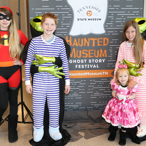 Haunted Museum participants pose in the photo booth.