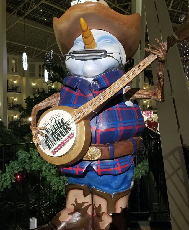 A snowman sculpture welcoming you to A Country Christmas.