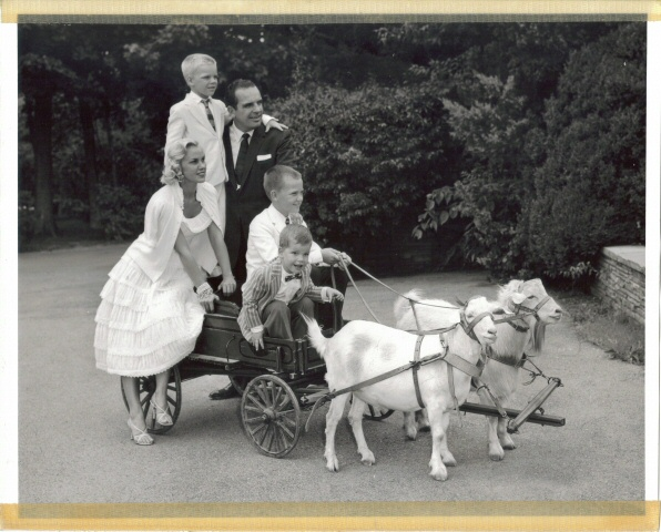 Goats can be used in many ways. This is a Former Governor Clements riding in a goat cart with his family.