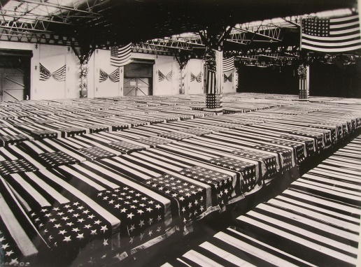 Flag-draped coffins of repatriated American dead at Antwerp ready for shipment back to the U.S. in 1921.  Signal Corps photo #104282