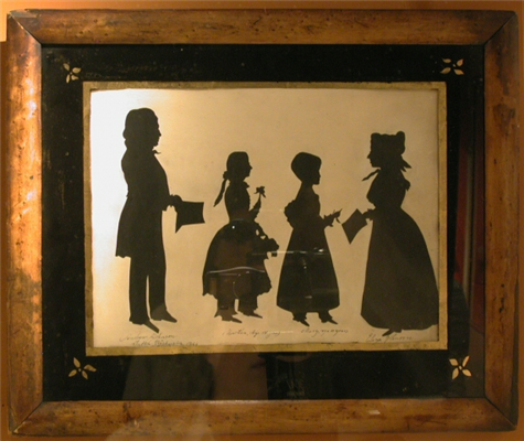 "A silhouette of Andrew and Eliza Johnson, with their daughters Martha and Mary, ""taken in Washington in 1843."""