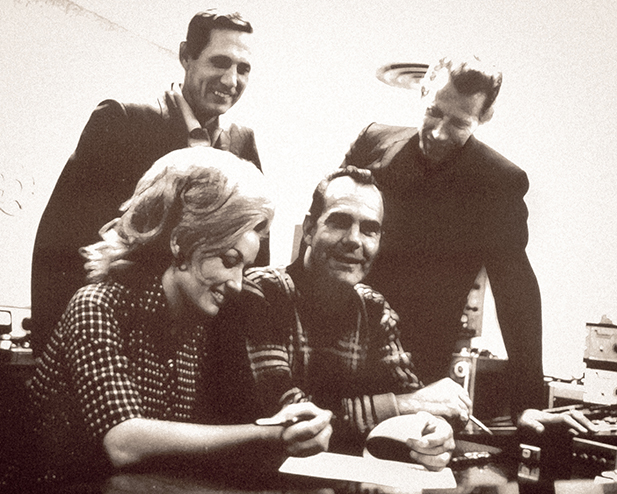 Dolly signing with RCA in 1967. Courtesy of Chasing Rainbows Museum.  Permission from the Chet Atkins Estate.