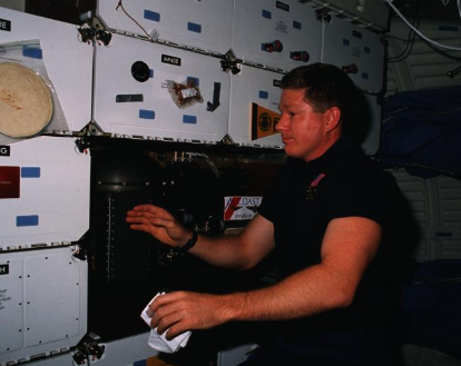 Bill Shepherd doing an experiment on STS-41, NASA (National Archives)