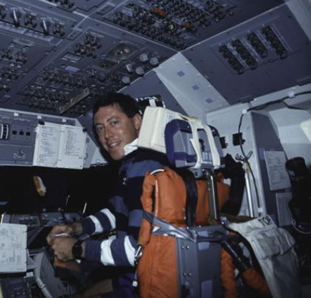 """Mike Baker in pilot seat of """"Atlantis"""" shuttle during STS-43, NASA (National Archives)"""
