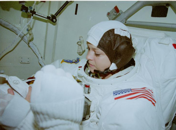 MS Tammy Jernigan preparing for a spacewalk on STS-80, NASA (National Archives)