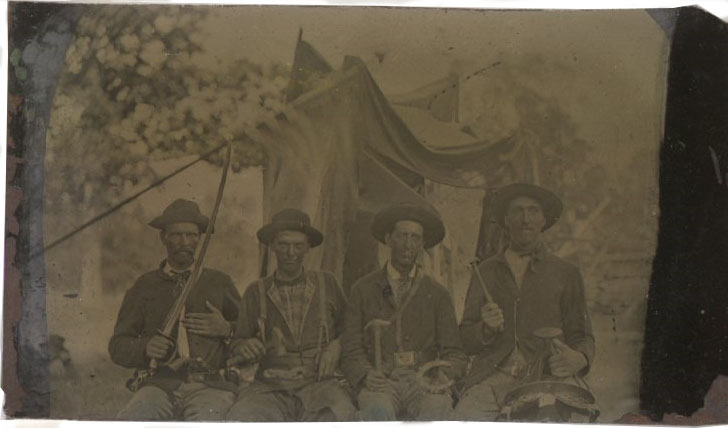 Tintype, Thomas H. McLain, Michael H. Martin, E. E. Ferguson, and A. J. Shupe, Co. I, 8th Tennessee Cavalry, U.S.A., with regimental flags. 92.93.22