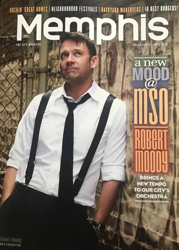 man with suspenders on looking up on magazine cover