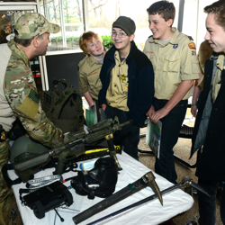 Practicing gun safety! Members of law enforcement teach boy scouts about different types of firearms during Scouts Rock at Graceland.