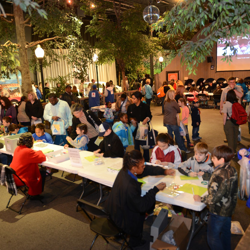 Scouts write special thank you notes to our military during the 2014 Scouts Rock at Graceland.