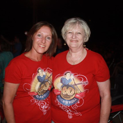 Elvis fans rock their 60 years tees while attending the 60 Years Celebration Concert at the Levitt Shell.