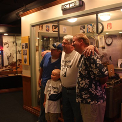 Dewey Phillips family take photos with his new exhibit now on display at Sun Studio.
