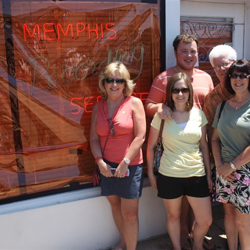 Elvis fans take photos outside Sun Studio on July 5, 2014.