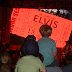Tiny Elvis fans get a front row seat to the show during the 60 Years of Rock