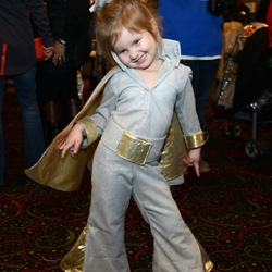 A young Elvis fan enjoys the Lighting Ceremony.