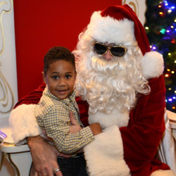 An Elvis-inspired Santa spent time with kids at the Graceland Lighting Ceremony.