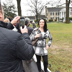 Fans posed for photos on the lawn of Graceland on January 8, 2016.
