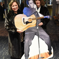 Elvis fans snapped photos with Elvis cutouts at the Memphis Symphony Orchestra show.