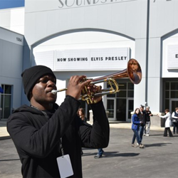 Trumpet player Jawaun C. played Elvis classics for fans during the Grand Opening Celebration.