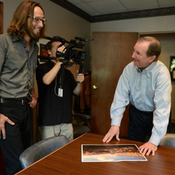 Elvis Week Video Host Memphis Jones gets a peek at the plans for the Guest House at Graceland.