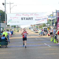 Runners cross the finish line during the annual Elvis Presley 5K.