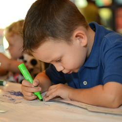 Fans draw and color during the Kids Activities in the Graceland Ticket Pavilion.