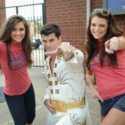 The Red Hots snap a photo with the Graceland ambassador during Elvis Night with the Memphis Redbirds.